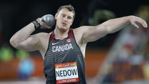 Tim Nedow in Canada singlet prepares to throw shotput